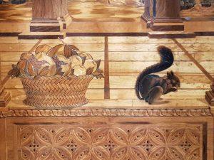 Studiolo di Urbino - dettaglio della finestra, immagini del cesto di frutta e dello scoiattolo