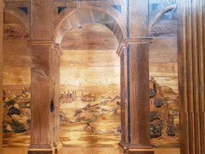 Studiolo di Urbino - dettaglio della finestra, immagini del loggiato e del paesaggio retrostante